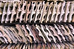 Old roofing tiles stored on wooden shelves. Old used roofing tiles stored on wooden shelves stock photography