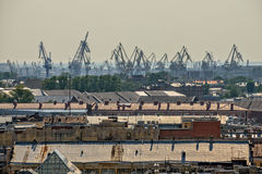 Old roofs in central part of St. Petersburg and port cranes Royalty Free Stock Photography
