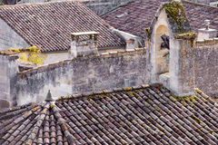 Old roofs in the city St. Emilion in France. Old roof with roof tiles in St. Emilion in the region of Bordeaux, France royalty free stock image