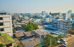 Chanayethazan township of Mandalay, Myanmar. The old roofs and modern buildings of Chanayethazan Township in downtown of Mandalay, Myanmar stock photo