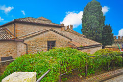 Old roofs under a blue sky with clouds in Gradara Royalty Free Stock Photo