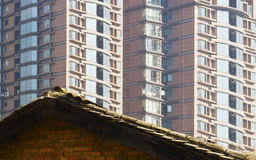 Old rooftop vs new windows. Chinese city skyline showing contrast between old roof and modern high rise building, Kunming, Yunnan, China Stock Photo