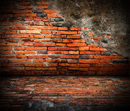 Old room with brick wall. Grunge industrial interior Uneven diffuse lighting version. Design component Stock Photo