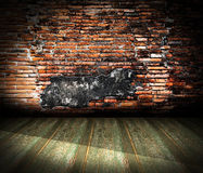 Old room with brick wall. Grunge industrial interior Uneven diffuse lighting version. Design component Royalty Free Stock Photos
