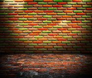 Old room with brick wall. Grunge industrial interior Uneven diffuse lighting version. Design component Royalty Free Stock Images