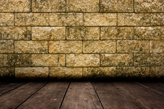Old room with brick wall and wood floor. Stock Image