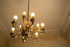 Old room and chandelier. Old lamp in old room stock images