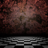 Old room with checkerd floor Stock Images