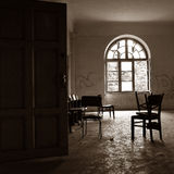 OLD ROOM IN DARK PROFILE. WITH A CHAIR Stock Photography