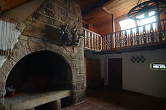 Old room with fireplace Stock Images