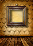 Old room, grunge  interior with frames Royalty Free Stock Photo