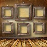 Old room, grunge  interior with frames Stock Photo