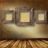 Old room, grunge  interior with frames Royalty Free Stock Image