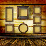 Old room, grunge  interior with frames Royalty Free Stock Images