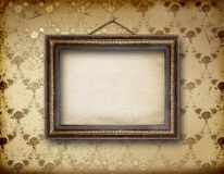 Old room, grunge interior with frames Royalty Free Stock Photography