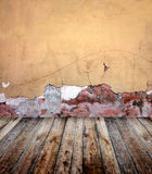 Old room with stucco wall. And wooden floor Royalty Free Stock Photography