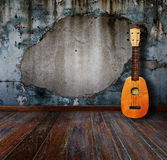 Old room. Ukulele in old room Stock Photos