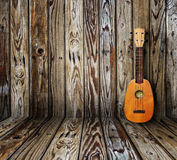 Old room. Ukulele in vintage wood room Stock Photography