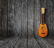 Old room. Ukulele in vintage wood room Royalty Free Stock Images