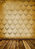 Old room with worn wallpaper Stock Images