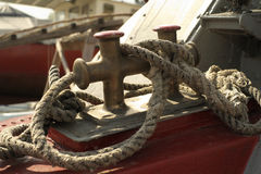 Old rope. On the bow of old motorboat Royalty Free Stock Photography