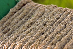 Old rope. Fibers impregnated with sea water and discolored Royalty Free Stock Photo