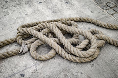 Old rope on the ground Stock Photo