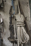Old rope hanging on the wall Stock Photos