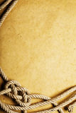 Old rope and knot on paper Royalty Free Stock Photography