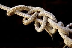 Old rope with knots. Shadow DOF Royalty Free Stock Images