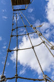 Old rope ladder against cloudy sky Stock Photography