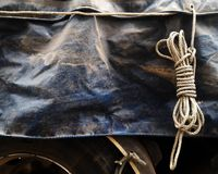 Old rope loop and dirty old canvas covered truck on truck for transportation background Stock Image