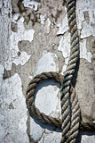 Old Rope and Peeled Paint. A detailed close up macro photograph of a section of an old metal life boat and rope. A great texture image for a background or royalty free stock image