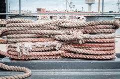 Old rope tied with a ship cleat Stock Image