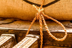 Old rope used to tide up bags of grain Stock Photos