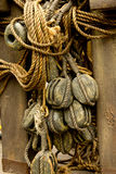 Old rope and wooden block pulleys. An old rope and wooden block pulleys of an old pirate ship stock images
