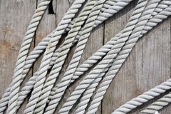Old rope on wooden deck. Close up of old rope on wooden deck Royalty Free Stock Images