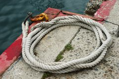 Old ropes on the dock Stock Images