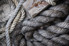 Old ropes on dock Stock Images