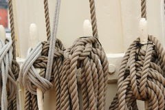 Old ropes on sailingship. Ropes on sailing ship to secure sails Stock Photo