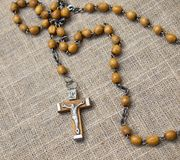Old rosary with wooden beads, 2 Royalty Free Stock Photos