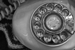 Old Rotary Dial Phone. A Black and White Photo of an Old Rotary Dial Phone royalty free stock photography
