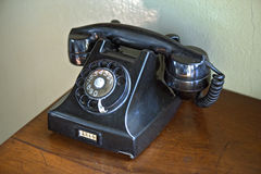 Old rotary dial telephone Stock Photography