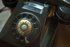 Old rotary dial telephone Stock Photo