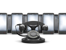 Old rotary phone and modern cell phones Royalty Free Stock Photography