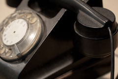Old rotary phone. Old used black rotary phone stock photo