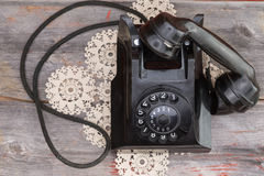 Old rotary telephone with the handset off the hook Stock Photo