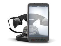Old rotary telephone and modern cell phone Royalty Free Stock Photography