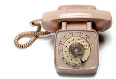 Old rotary telephone on white Stock Photos