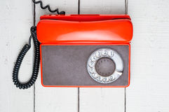 Old rotary telephone on wooden background. Stock Images